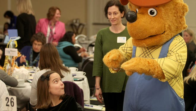Lucy Rood gets a visit from The Berenstain Bears' Papa Q. Bear during the 2012 One Book Two Book Festival.