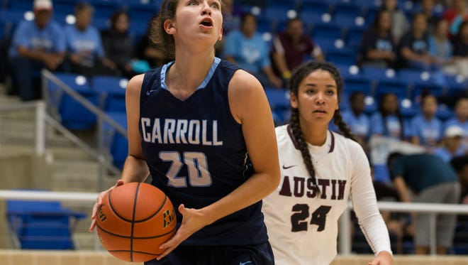 Carroll's Izzy Beletic drives the ball the basket during the first quater of the Region IV-5A Tournament at the Northside Spots Gym in San Antonio on Friday, Feb. 24, 2017.