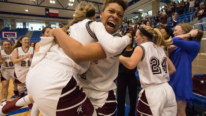 Four Bluff's Armani Anderson hugs Meredith Marcum as the team celebrates defeating Stephen F. Austin and winning the Region IV-5A Tournament championship game at Northside Spots Gym in San Antonio on Saturday, Feb. 25, 2017.