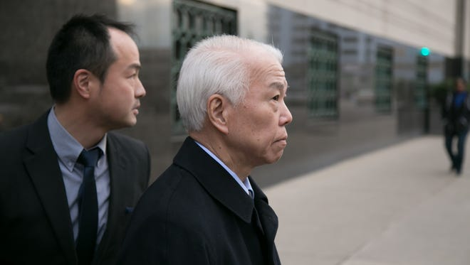 Yoichiro Nomura (center), Takata's chief financial officer, exits the U.S. District Court in downtown Detroit on Monday February 27, 2017 after $1 billion settlement with the U.S. Department of Justice in regards to the companies defective airbag inflators.