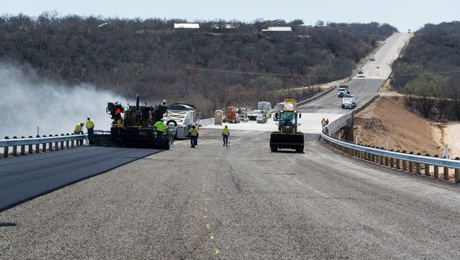 Hot mix is applied to the State Highway 6 bridge north of Cisco. The bridge has been completed and is open to traffic.