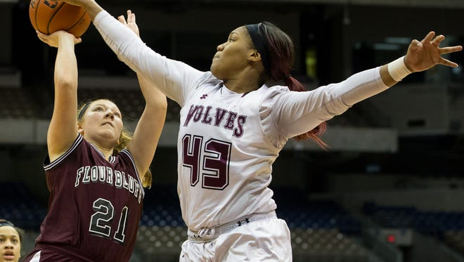 Mansfield Timberview's Lauryn Thompson blocks Flour Bluff's Ciera Baucom's shot during the fourth quarter of the Class 5A state semifinal at the Alamodome in San Antonio on Thursday, March. 2, 2017