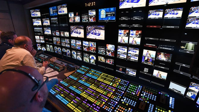 Crews work in the ESPN truck to broadcast the SEC Women's Tournament in Greenville on Friday, March 3, 2017.