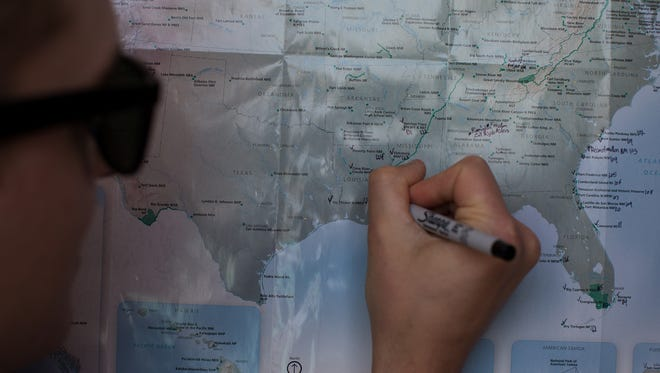 Mikah Meyer marks Padre Island National Seashore on his trip map as his 127th visited national park Tuesday, March 7, 2017, as he seeks to become the youngest person to visit all the National Park Service sites.