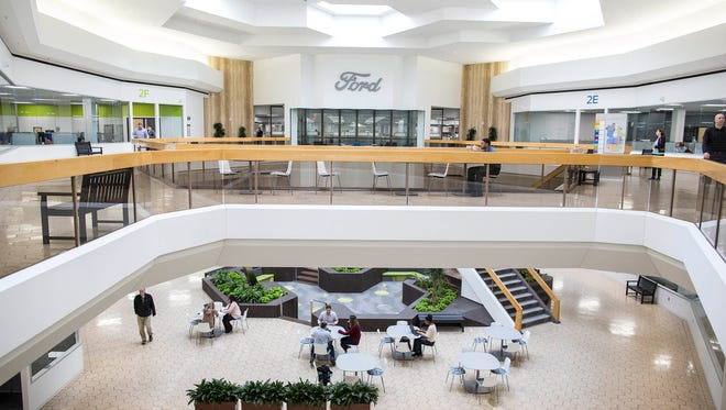 More than 1,800 Ford employees have moved into retail space previously occupied by Lord & Taylor and other retailers at Fairlane Town Center and will work out of the mall for the next 10 years while the automaker renovates a number of its offices in Dearborn.