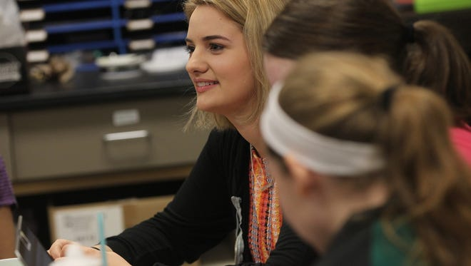 West High senior Isabelle Robles brainstorms ideas with classmates during the West Side Story's class period on Thursday, March 9, 2017. Robles serves as the paper's digital editor-in-chief and was recently recognized as the Iowa High School Press Association's student of the year.