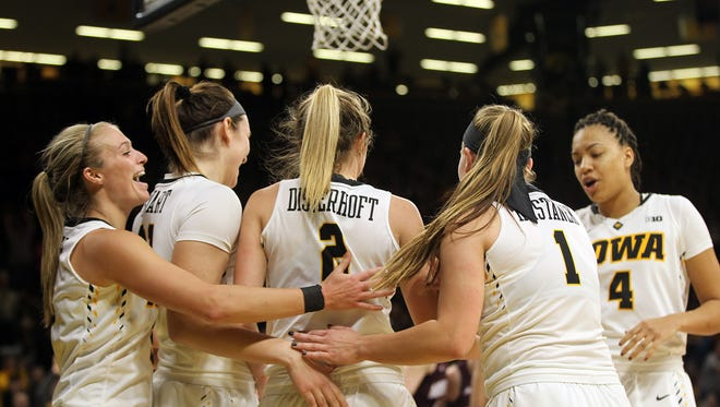 Iowa's Ally Disterhoft gets a group hug after breaking Iowa's all-time scoring record during the Hawkeyes' WNIT first round game against Missouri State at Carver-Hawkeye Arena on Thursday, March 16, 2017.
