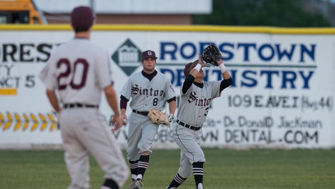 Sinton's Mike Mendez catches a pop up for an out during the second inning of their game against Robstown at Steve Castro Field in Robstown, on Friday, March 17, 2017.