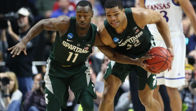 Mar 19, 2017; Tulsa, OK, USA; Michigan State Spartans guard Lourawls Nairn Jr. (11) and guard Miles Bridges (22) work to control the ball during the first half against the Kansas Jayhawks in the second round of the 2017 NCAA Tournament at BOK Center. Mandatory Credit: Kevin Jairaj-USA TODAY Sports