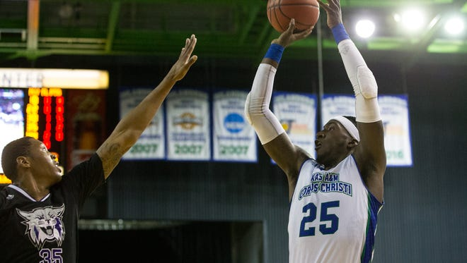 Islanders Rashawn Thomas jumps to make a shot as Wildcats Kyndahl Hill tries to block him during the first half of second round CollegeInsider.com Tournament game at American Bank Center on Monday, March 20, 2017.