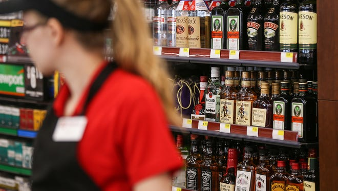 Liquor is kept behind the counter at a Ricker's convenience store in Columbus, Ind., Thursday, March 23, 2017. Servers must bring the beer to a patron's table in the store's restaurant area. After the chain's lawyers realized the in-store restaurants qualified for cold beer sales, this Ricker's location and one in Sheridan, Ind., obtained the required licenses to serve cold beer to patrons for consumption in the restaurant or to-go. The Columbus location also sells liquor for consumption outside of the restaurant. To many in the liquor store industry, Ricker's use of this loophole seems like an attempt to cut into an area that has previously been domain of liquor stores, which are subject to additional regulations.