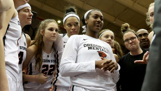Oregon State players huddle together following the