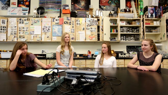 Emma Fagan, from left, a junior, Alexa Montgomery, a sophomore, Marcella Cross, a junior, and Sophia Hawley, a sophomore, speak on their futuristic lithium-ion battery improvement technology that won the regional championships for the ExploraVision science competition. Photographed at West Salem High School on Thursday, March 23, 2017. The team now needs to create prototype, video and website explaining their technology for the national competition.