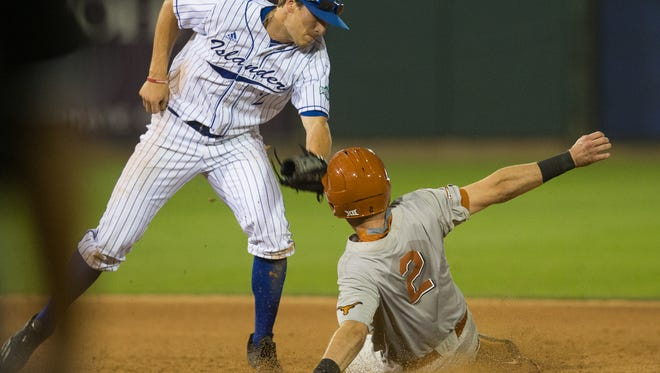 Islanders' second basemen Luke Marbach tags out University of Texas's Kody Clemens during the fourth inning for their game at Whataburger Field on Tuesday, March 28, 2017.