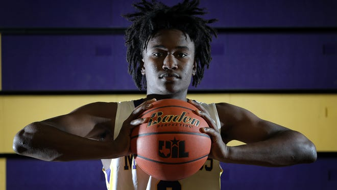 Burges junior Jawaun Newton is the El Paso Times' Boy's Basketball MVP for the 2016-2017 season.