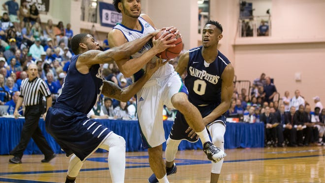 Texas A&M-Corpus Christi's Ehab Amin is fouled as he drives the ball to the basket during the first half of the College Insider.com Tournament final against Saint PeterÕs at Dugan Wellness Center on Friday, March 31, 2017.