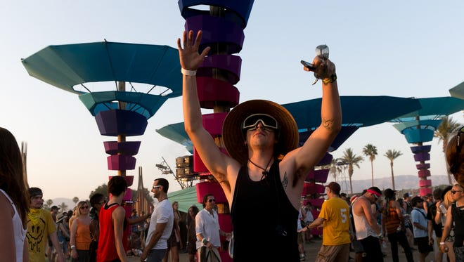 Coachella fans hang out at the Do Lab during the 2014 Coachella Valley Music & Festival. The musical stage and art piece returns with a new design this weekend.
