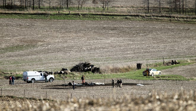 Local law enforcement investigate a plane crash in an Oxford cornfield on Friday, April 7, 2017.