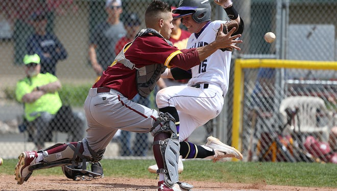 Lambkins' Lane Brlecic dives for home plate during Rocky Mountain's 13-6 win over Fort Collins on Saturday, April 8, 2017 at City Park Field in Fort Collins. Brlecic would be safe on the play as part of a Fort Collins' run. (Photo by Brian Smith/for the Coloradoan)