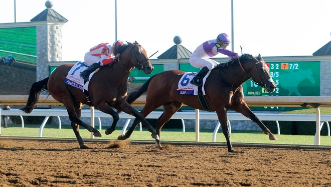 Reddam Racing's Irad and jockey Julien Leparoux lead favorite McCraken, left, to the finish line in the grade 1 $1,000,000 Toyota Blue Grass Stakes at Keeneland Race Course in Lexington, Ky., Saturday, April 8, 2017.