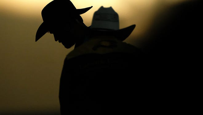 As the sun sets light is cast across B.W. Pickett Equine Center as competitors prepare before Colorado State's Skyline Stampede rodeo on Saturday, April 8, 2017 in Fort Collins.