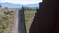 A fence runs along a portion of the U.S.-Mexico border