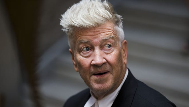 David Lynch walks during a press preview of David Lynch: The Unified Field, Wednesday, Sept. 10, 2014, at his former school The Pennsylvania Academy of the Fine Arts (PAFA) in Philadelphia. The show is schedule to be on view from Sept. 13, 2014 to Jan. 11, 2015, and is the first major U.S. museum exhibition of the filmmaker and PAFA alumnus' work. (AP Photo/Matt Rourke)
