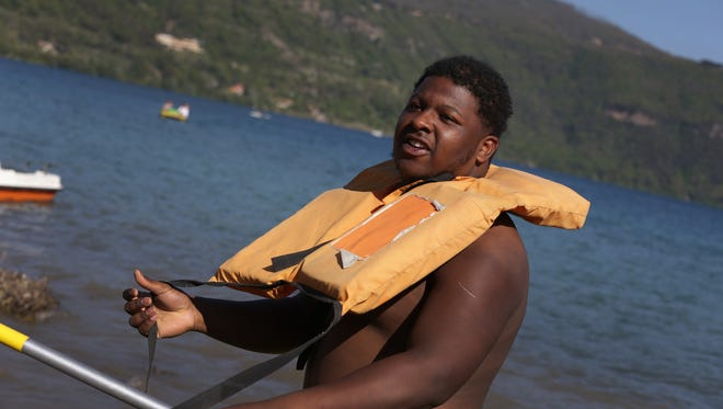 Michigan football player Cesar Ruiz gets ready to take a canoe ride at Ninfe Beach on Lake Albano on the Wolverines third day in Italy on Tuesday, April 25, 2017.