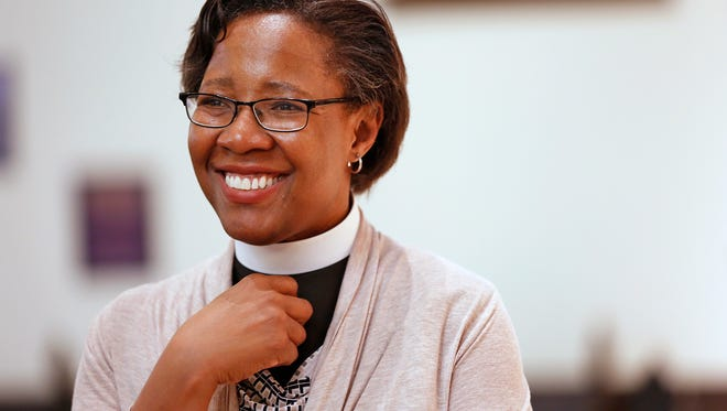 Jennifer Baskerville-Burrows, Bishop-Elect of the Diocese of Indianapolis in the Episcopal Church, answers questions from a reporter as she visits Christ Church Cathedral, Tuesday, April 25, 2017.  She will become the first African American woman to lead an Episcopal Diocese.