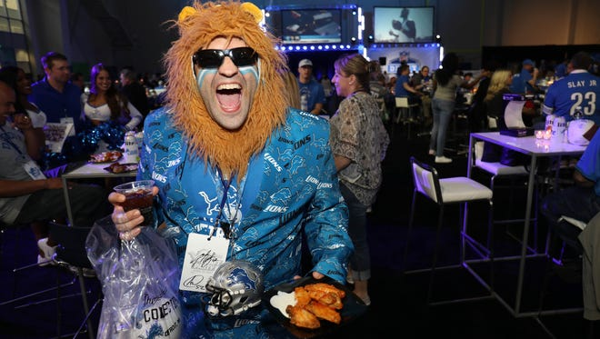 Lions fan Ed Griswald dressed up for the NFL draft party at the Allen Park practice facility Thursday, April 27, 2017.