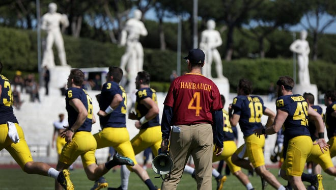 University of Michigan head football coach Jim Harbaugh leads his Wolverines during their last practice at Stadio dei Marmi in Rome on Saturday, April 29, 2017.