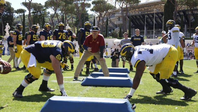 University of Michigan head football coach Jim Harbaugh leads his Wolverines through drills during their last practice at Stadio dei Marmi in Rome on Saturday, April 29, 2017.