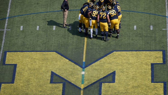 Apr 15, 2017; Ann Arbor, MI, USA; Michigan Wolverines head coach Jim Harbaugh is seen in the huddle during the Michigan Spring Game at Michigan Stadium. Mandatory Credit: Rick Osentoski-USA TODAY Sports