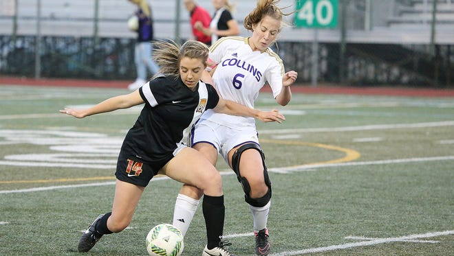 Rocky Mountain's Riley Ostler corrals a ball in front of Fort Collins' Addie Brown in a game earlier this season.