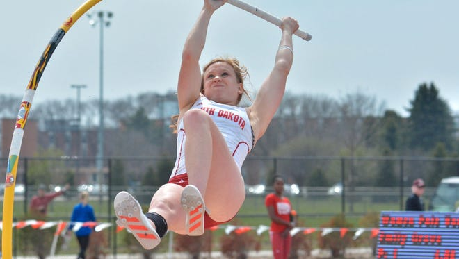 Shown here competing at the USD vs. SDSU meet in Vermillion, Emily Grove vaulted 15 feet, 1 inch in Sioux City on Friday.