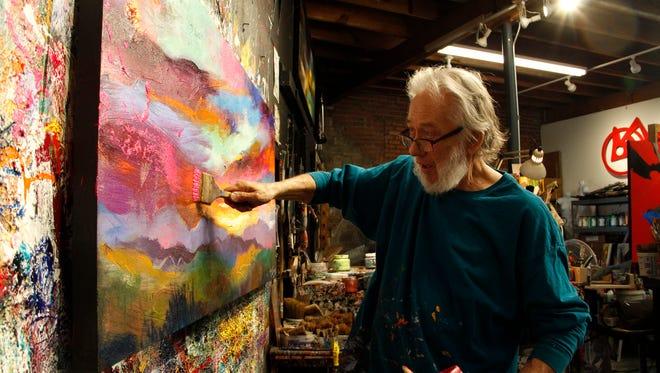 Asheville painter Jonas Gerard at work in his River Arts District studio.