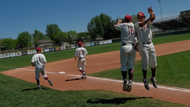 Rocky Mountain High School baseball players celebrate after a 16-0 win over Lincoln in the first round of district play. The Lobos won the district to advance to the 5A state tournament.