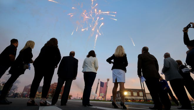 Carmel city officials watch the fireworks at the officially opening the city's 100th roundabout. Carmel celebrated the opening of its 100th roundabout at the intersection of Carmel Drive & Range Line Road Thursday, November 17, 206, evening in Carmel.