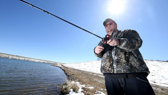 Kyle Clark fishes for bass at Pine Ridge Natural Area on the first day of spring onSunday,March 20, 2016, in Fort Collins, Colo. (Brian Smith/For the Coloradoan)