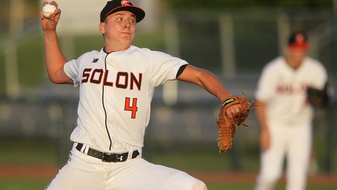 Solon's Cam Miller delivers a pitch during the Spartans' game against Regina in Solon on Thursday, May 25, 2017.