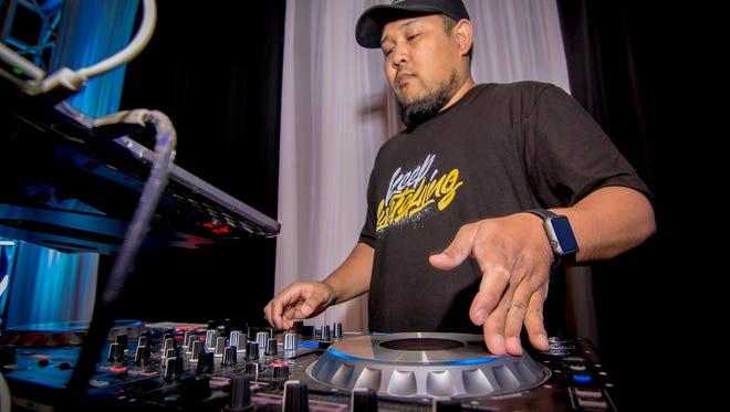 DJ JPOGI lays out the tracks at Cowboy Ninja.