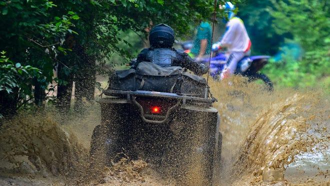 ATV riders enjoy the trails at Badlands in Attica.