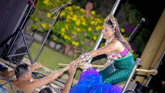 """Renae """"Mcphearson"""" Punzalan greets party goers during her Splish Splash Burlesque show at the poolside of Pacific Star Resort on May 28, 2017."""