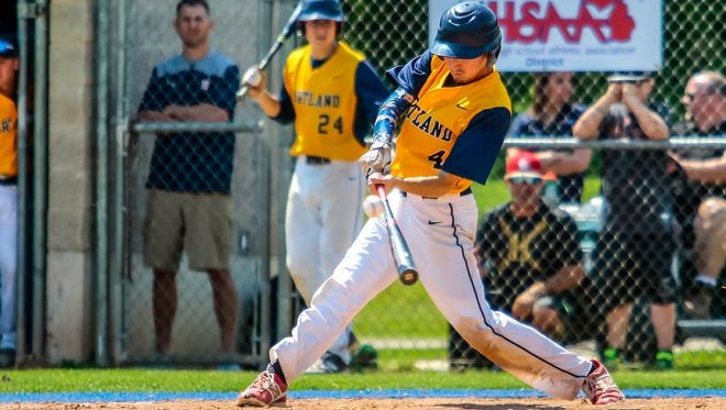 Justin McGrew (4) lashes a double to right field in Hartland's 11-8 come from behind victory over Milford in district play Friday.