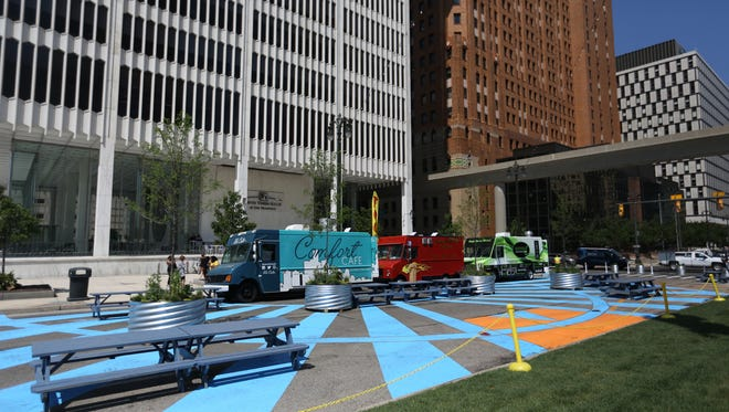 Food trucks line up for patrons during the ribbon-cutting ceremony for the opening of the Spirit of Detroit Plaza on Woodward Avenue between Jefferson avenue and Larned street on Monday, June 12, 2017.