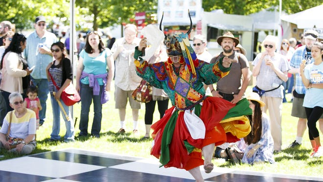 Ven. Karma Namgyel Rinpoche performs a Bhutanese Garuda dance at last year's World Beat. More than 100 culture performances will take place over the two-day event this year, June 24-25.