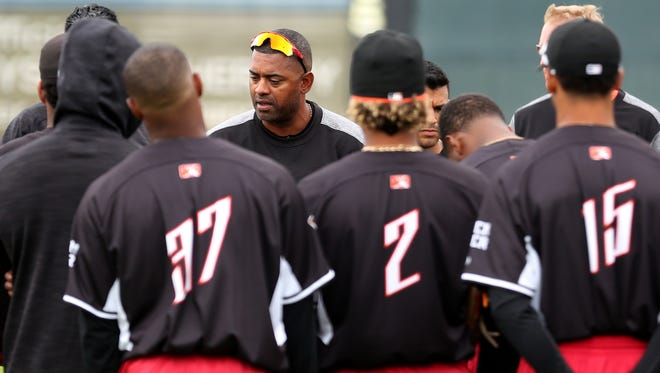 Jolbert Cabrera, the manager of the Salem-Keizer Volcanoes minor league baseball team, talks to players during their first practice of the season at Volcanoes Stadium in Keizer on Monday, June 12, 2017.