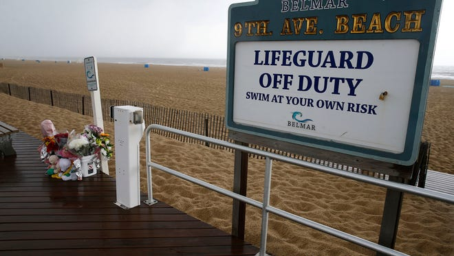 A memorial for the two girls who drowned while swimming at an unattended beach is shown on the Belmar Belmar boardwalk at 9th Avenue Monday afternoon, June 19, 2017.