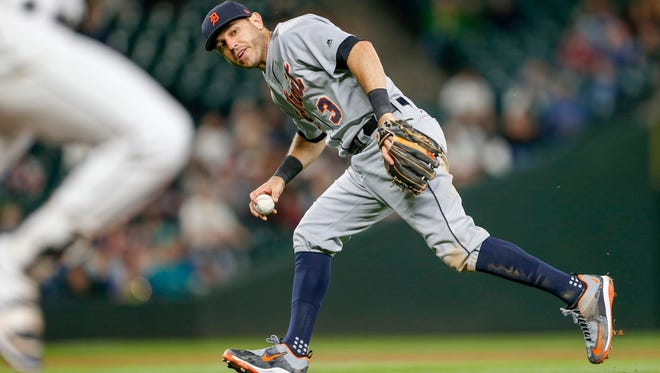 Tigers second baseman Ian Kinsler (3) looks to first after fielding a bunt during the sixth inning Monday in Seattle.