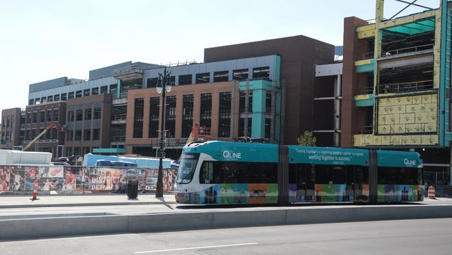 A QLINE car drives by a section of the Little Caesars Arena in downtown Detroit on Woodward Ave. on Monday June 12, 2017.